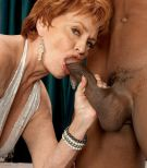 Crimson hair grannie adult movie star Valerie slurping off a huge ebony rod in milky lingerie