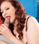 Redheaded 60 plus MILF prostitute Katherine Merlot giving massive sausage handjob and blow job