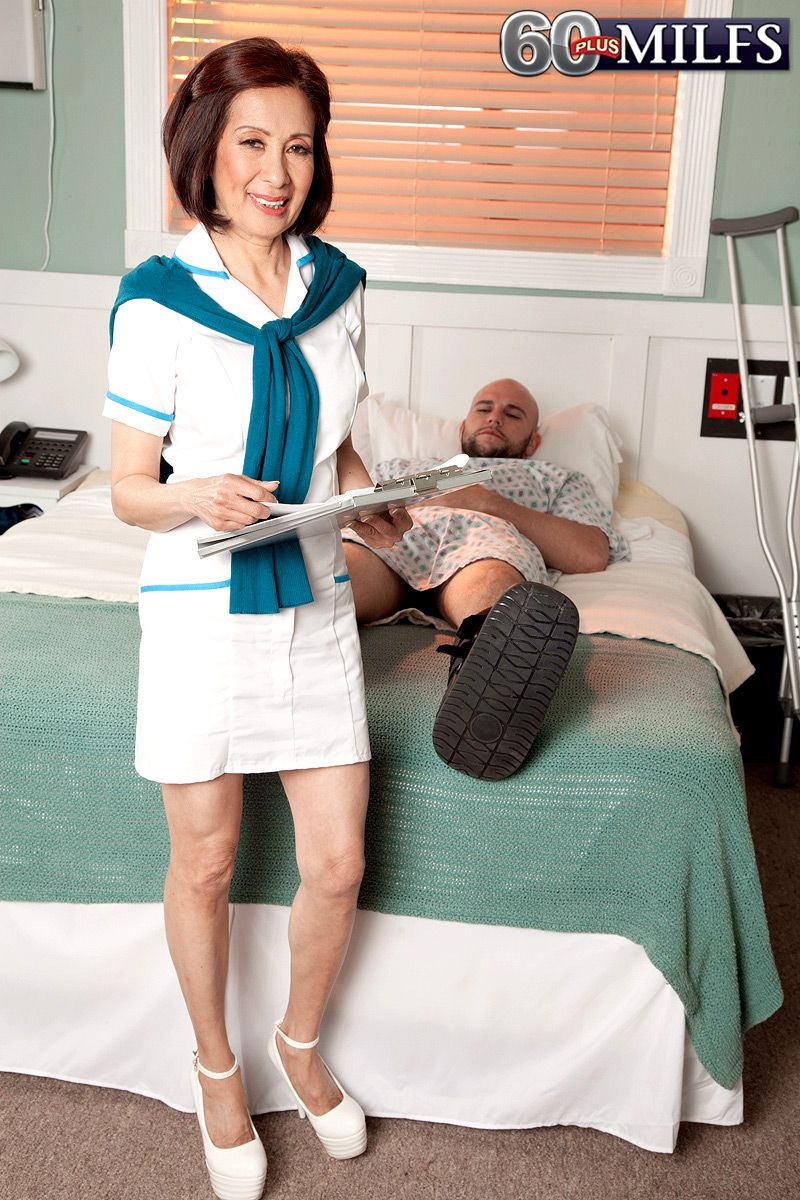 Mature Oriental nurse Kim Anh tugging and jerking off big dick in hospital
