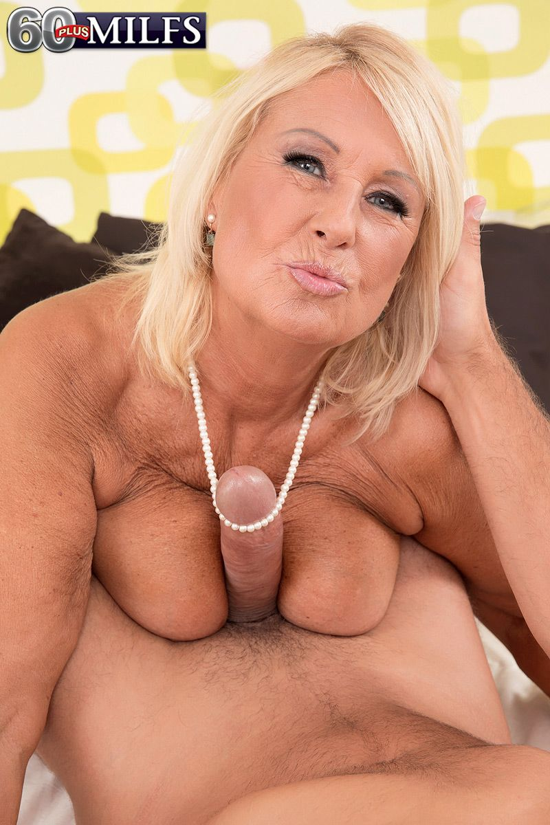Hot blonde granny over 60 Regi licking a long cock in lingerie and pantyhose