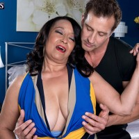 Busty 60 plus granny Rochelle Sweet having nipples and tits sucked by young stud