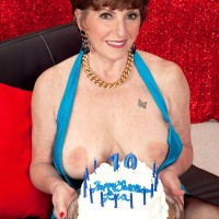 70 plus MILF Bea Cummins baring large natural tits for birthday fuck in stockings
