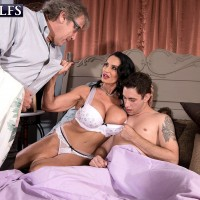 Busty brunette 60 plus pornstar having sex with younger man while hubby watches