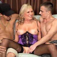 Hot 60 plus blonde MILF in stockings and lingerie having MMF with younger men