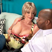 Busty older blonde babe Lexi McCain sucking off a big black cock