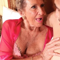 70 plus granny pornstar Sandra Ann fucking a younger stud in lingerie