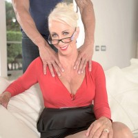 Aged yellow-haired XXX flick starlet Madison Milstar displaying monster-sized melons and upskirt panties