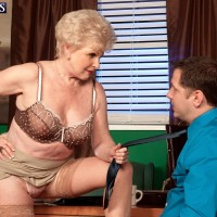 Grannie X-rated star Jewel seducing sex from junior dude in office attired tan hosiery