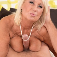 Huge-chested fair-haired grandmother in stockings and lingerie giving big wood titjob and BJ