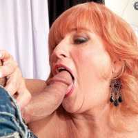 Leggy red-haired granny Jackie having huge boobs fellated before delivering immense knob blowjob