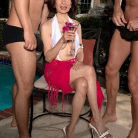 Over 60 Asian MILF Kim Anh draining off large rods outdoors before MMF sex