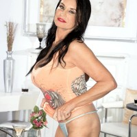 Over 60 dark-haired MILF Rita Daniels flashing fine legs and immense knockers