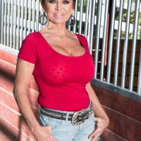 Over 60 lady Gina Milanos seduces a young dude with her massive hooters in denim shorts