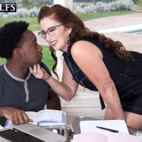 Over Sixty gal Maria Fawndeli seduces a younger ebony dude while tutoring him
