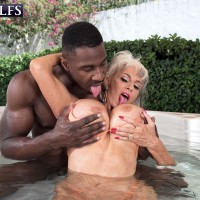 Sex grannie Sally D'Angelo and her monster-sized boobs take on a BBC outdoors in a Jacuzzi