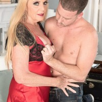 Stocking and lingerie outfitted Sixty plus yellow-haired MILF Charlie releasing large juggs for nip play