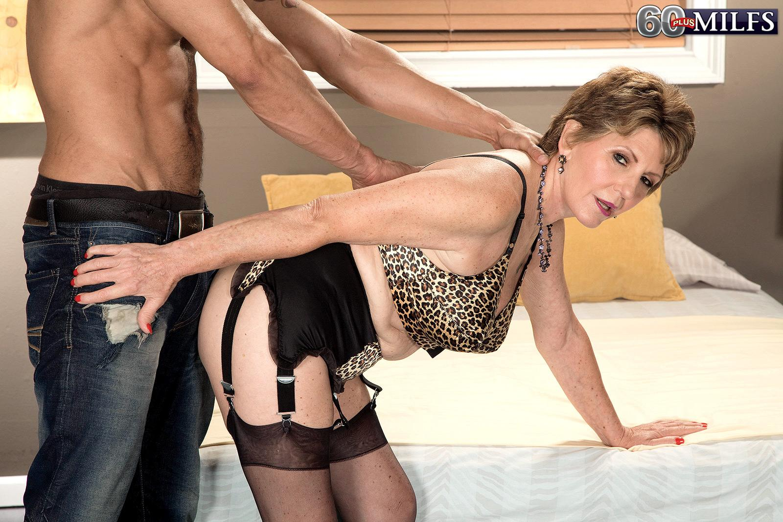 stocking outfitted granny bea cummins delivering big ebony cock hand