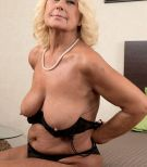 Blonde MILF over 60 Regi undressing to bare big saggy boobs