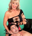 Beautiful grandma X-rated actress Phoenix Skye seducing sex from junior stud in tempting lingerie