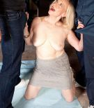 60 plus blonde grandmother Miranda Torri unsheathing giant aged breasts before MMF 3some