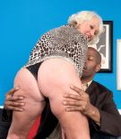 Golden-haired grandma Jeannie Lou giving large ebony penis interracial blow job in lingerie
