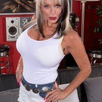 Buxom MILF Sally D'Angelo showing off her large over 60 tits
