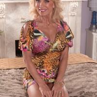 Blonde MILF over 60 Cara Reid having huge juggs exposed and nipples licked