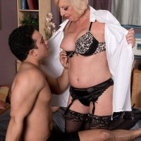 Sexy MILF 60+ Scarlet Andrews stroking younger man's cock in nylons and garters