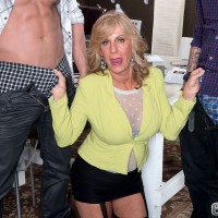 Blonde pornstar over 60 Phoenix Skye jerking off two fat cocks at once