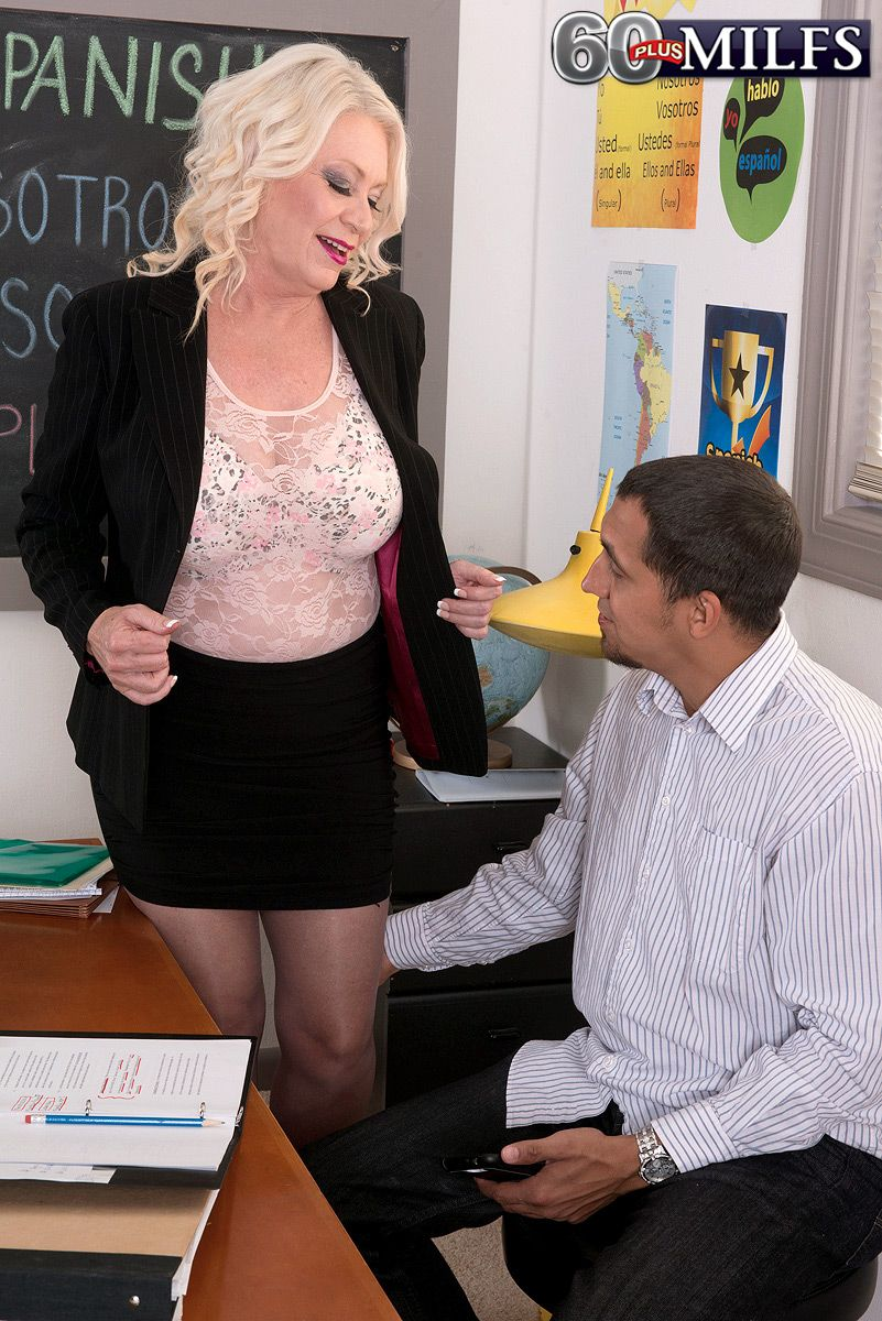 Busty blonde MILF over 60 Angelique DuBois looking hot in black nylons and skirt