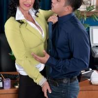 Skirt and nylon clad mature secretary Rita Daniels fucking young man in office