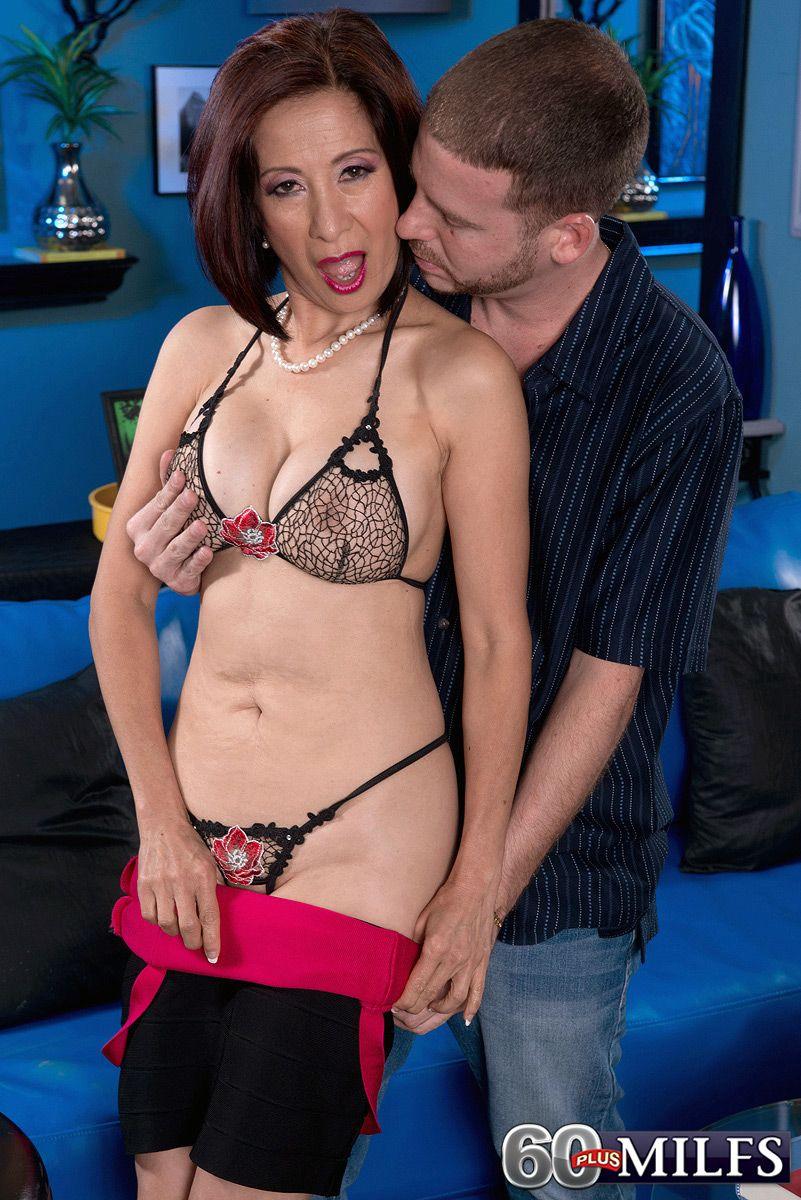 Hot 60+ Asian granny Kim Anh baring ass in thong panties for younger man