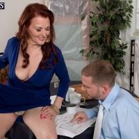 60+ redheaded MILF Katherine Merlot flashing upskirt panties at work