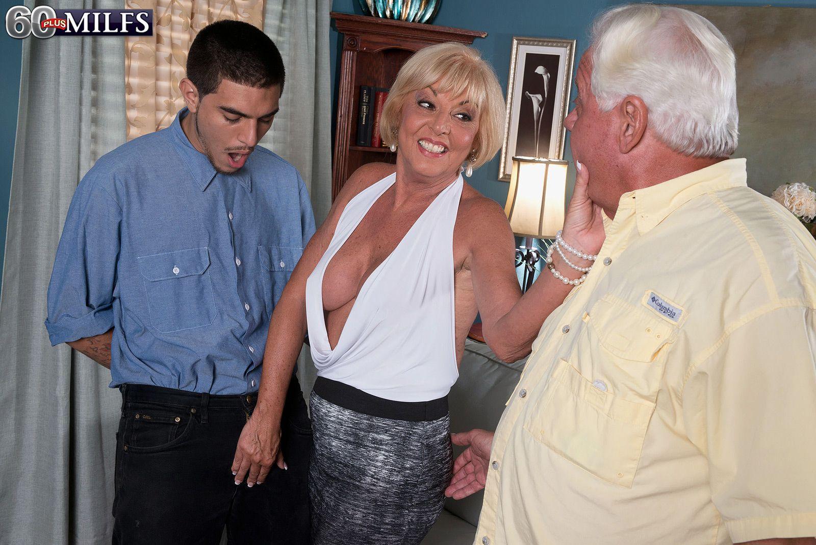 Buxom blonde granny over 60 Scarlett Andrews sucking dick in front of cuckold
