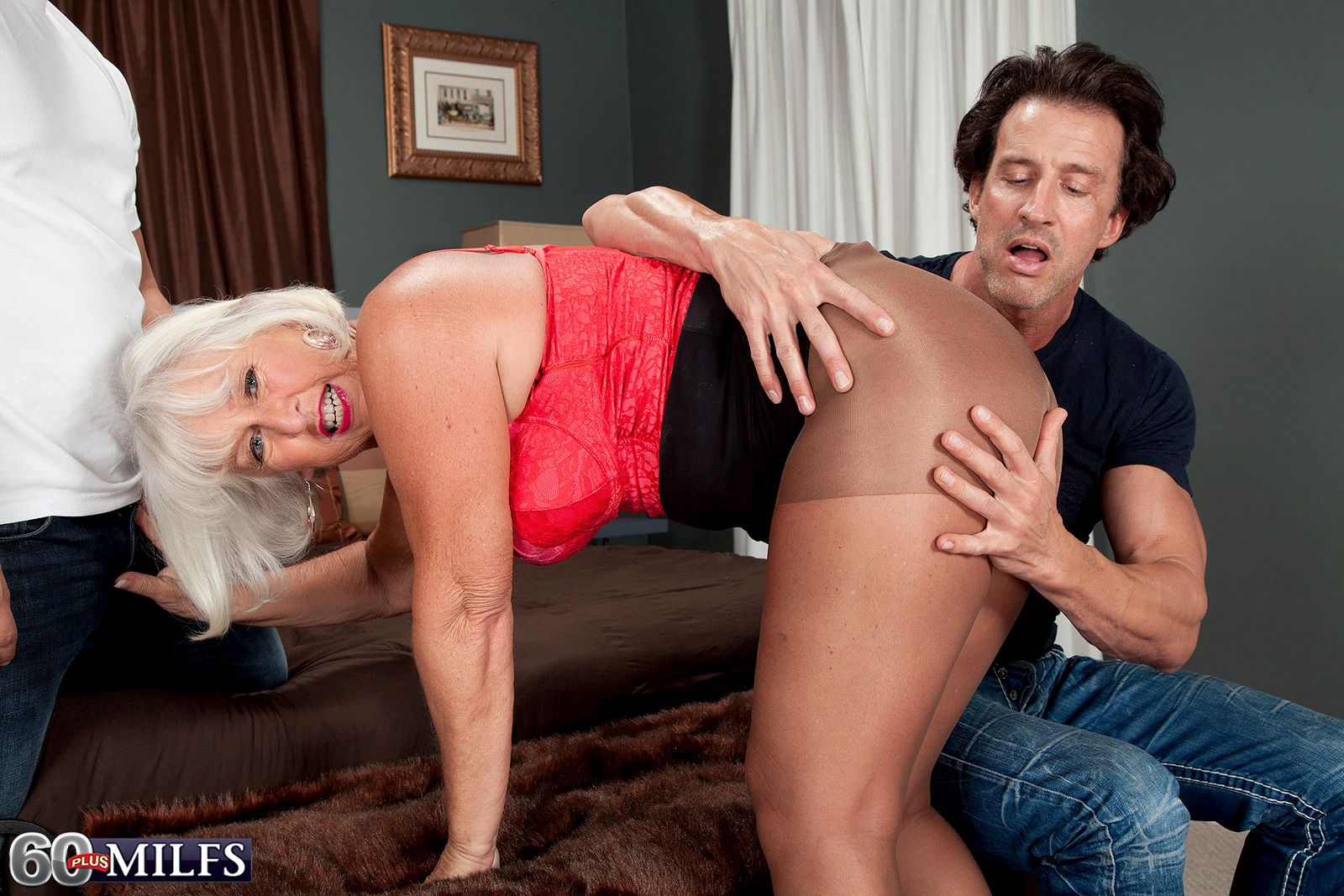Mature pornstar Jeannie Lou gets fucked by two younger cocks in wild MMF threeway