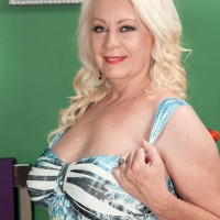 Buxom MILF over 60 Angelique DuBois exposing huge knockers and stroking cock