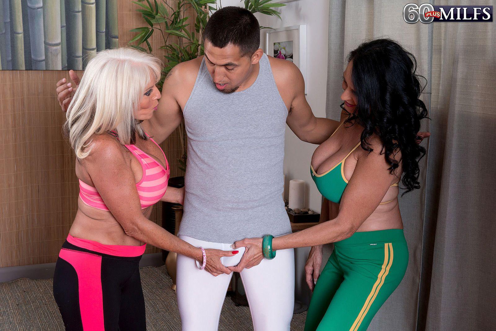 Mature lesbians Sally D'Angelo and Rita Daniels flashing big tits and French kissing