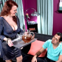 Busty redhead over 60 cougar Katherine Merlot seducing younger man for sex