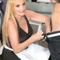Clothed 60+ MILF Charlie undresses younger man to jerk off cock