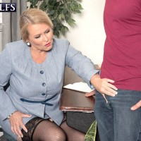 Older blonde woman Alice flashing upskirt thigh and giving a handjob in office