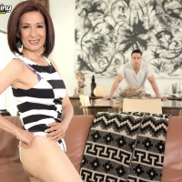 Petite Oriental granny with great legs exposes her thong while seducing a boy