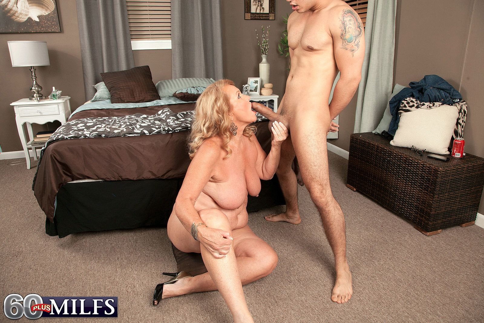 Blonde GILF seduces a young Latino lad while playing with her great tits