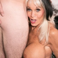 Sexy cougar seduces a young man while wearing an animal print miniskirt