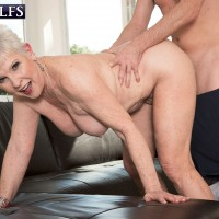 Sexy granny invites a boy to remove her bikini and rub her naked body with lotion