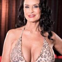 Busty mature brunette pornstar over 60 Rita Daniels stars in MMF threesome