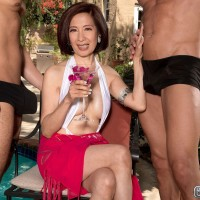 Asian MILF over 60 tangles with a couple of younger men near a swimming pool