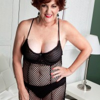Buxom MILF over 60 Gabriella LaMay releasing huge tits from mesh lingerie