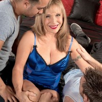 Busty 60 MILF with blonde hair has sexual relations with a couple of boys
