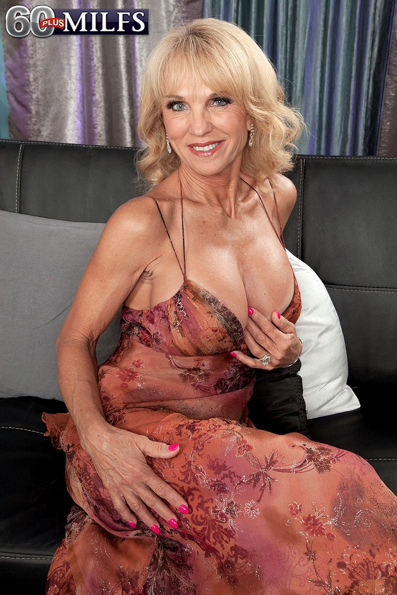 Hot blonde 60+ MILF Cara Reid having her huge knockers fondled by younger