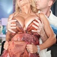 Hot blonde 60+ MILF Cara Reid having her huge knockers fondled by younger